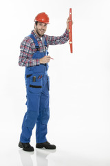 portrait of a craftsman with an hardhat and a level on isolated