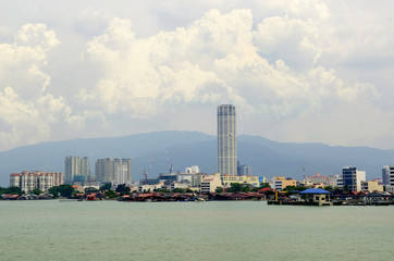 Penang cityscape with boats on ocean and skyscraper in Malaysia,