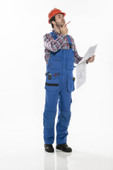 a craftsman in workwear clothing with an hardhat is examining bl