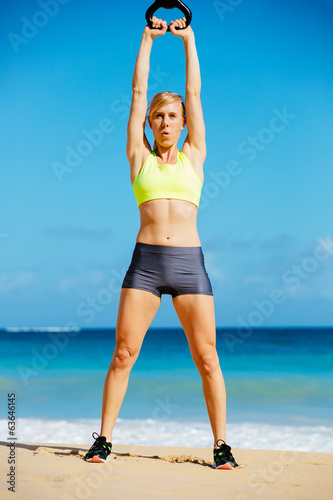 Attractive Athletic Woman Doing Kettle Bell Workout