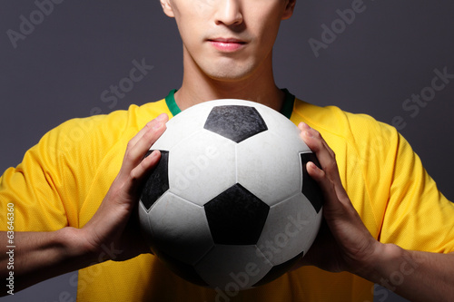 sport man smile and holding soccer
