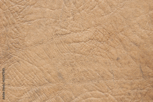 Leather texture. Closeup. Beige imitation leather.