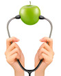 Stethoscope and a green apple. Medical background. Vector