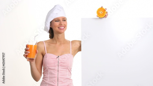 woman who explains the diet and wellness drinking a orange juice