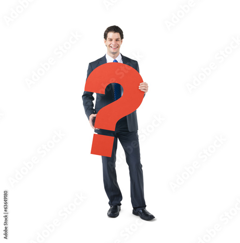 Cheerful Business Man Holding a Question Mark
