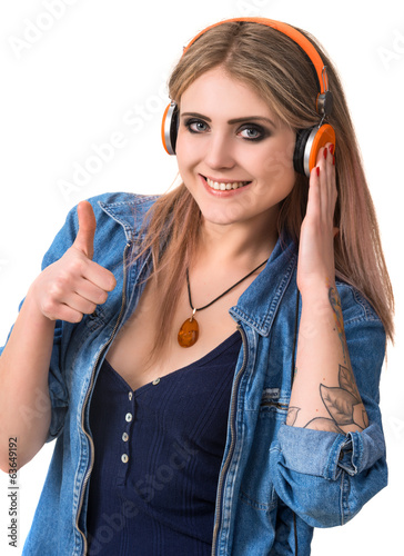 Smiling young girl in headphones
