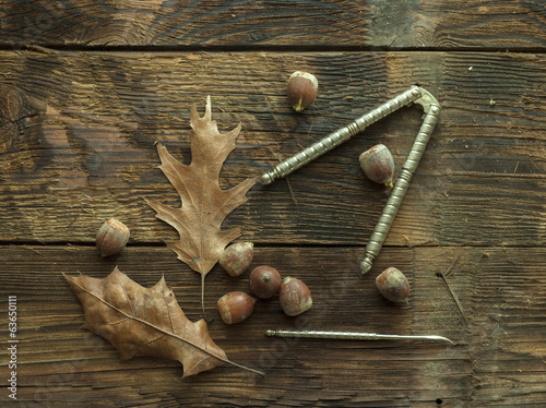 Acorns on rustic wood.