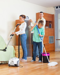 Family of three vacuuming together