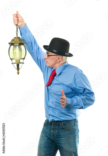 Man with lamp