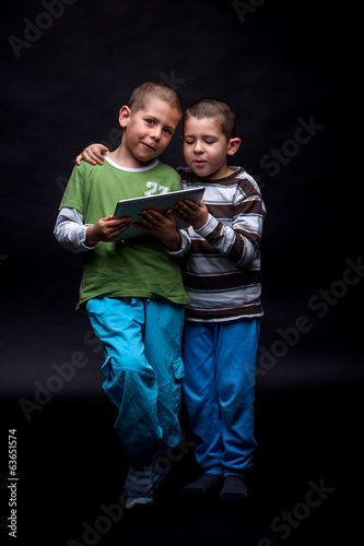 Boys using electronic tablet