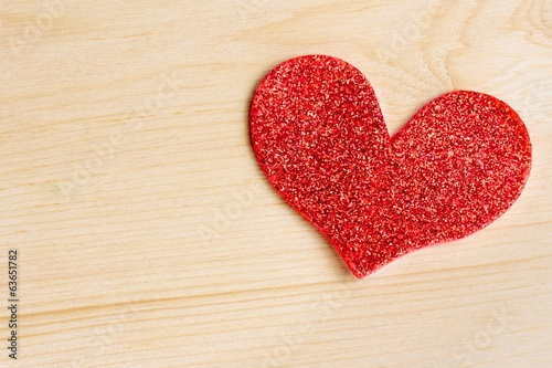 one decorative red heart on wood background, concept of love
