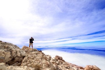 Man taking picture at top volcano Teide