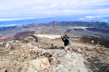 Man taking picture at top volcano Teide horizontal