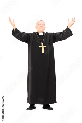 Mature priest with his hands in the air