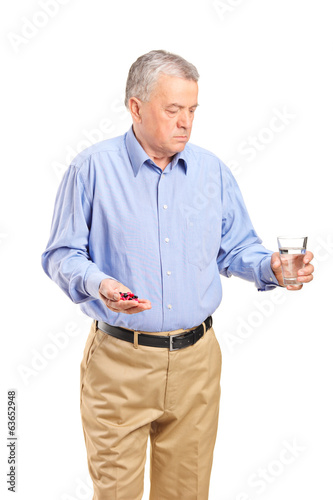 Mature man taking his medications