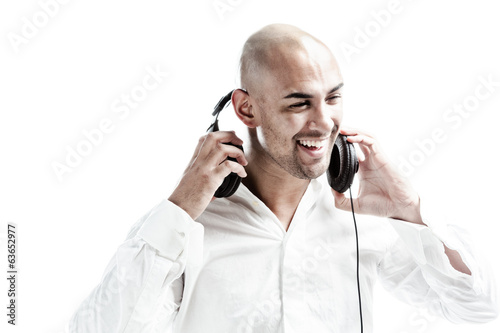 young man holding headphones smiling isolated on white