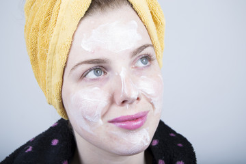 Woman without make-up moisturizing the skin (portrait)