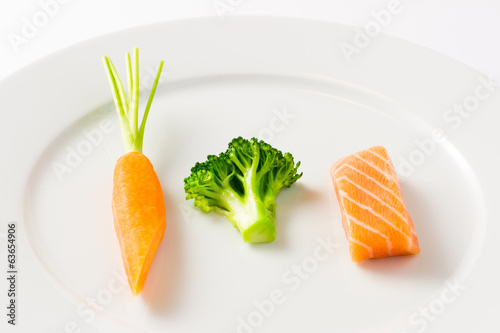 Raw food - salmon, broccoli, carrot - healthy food, DIET