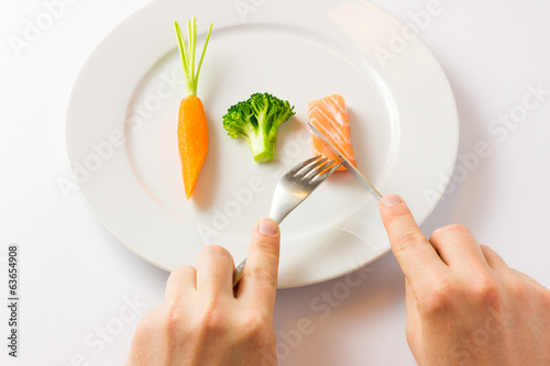 Picture for dieting, raw carrot, broccoli and salmon. DIET
