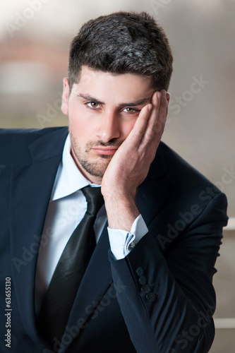 sad businessman in black suit and stress