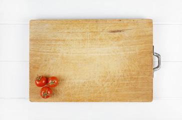 tomatoes on wood background