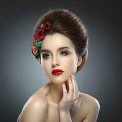 Woman Touching her Face. Beautiful girl with colored make up and