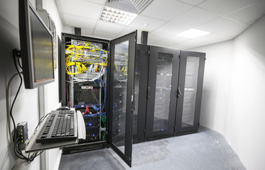 Modern server room interior with black computer cabinets and use