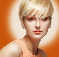 Beautiful Model Woman Face with orange makeup