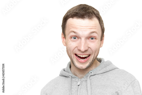 Laughing Caucasian man in sports jacket with hood. Portrait isol