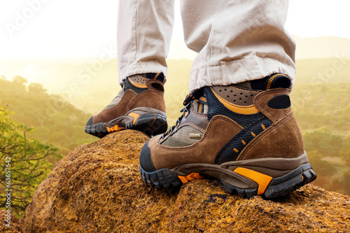Close up of hiker boots on rocks.