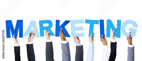 Business People Holding the Word Marketing