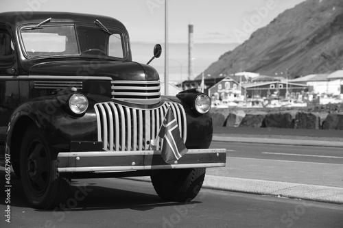 Iceland. Siglufjordur. Old Chevrolet truck and harbor.