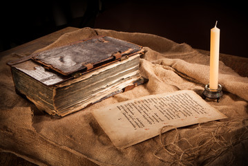 antique book, paper and candle