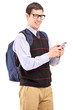 Man with backpack typing on his cell phone