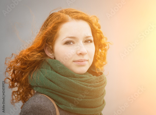 Beautiful redhead girl in the sunshine.