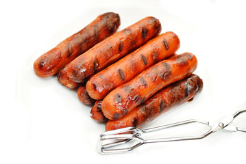 Picnic Hotdogs with Serving Tongs Over White