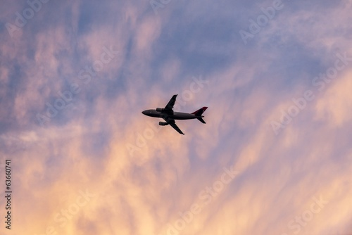 Tranquil sky with airplane traveling