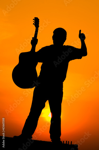 silhouette of guitar man