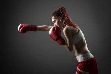 Boxing woman binds the bandage on his hand, before training
