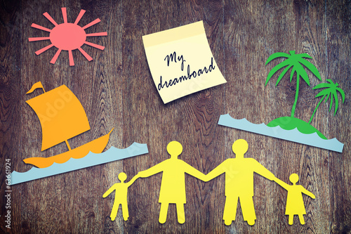 Happy family wishes map. Paper scraps on wooden surface