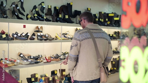 Couple shopping, looking at shoes at shoe store