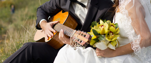 Bride and groom with the guitar