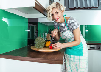 Housewife cooking healthy food at home