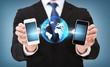 businessman showing smartphones