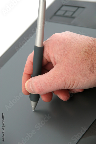 Designer drawing on graphic tablet