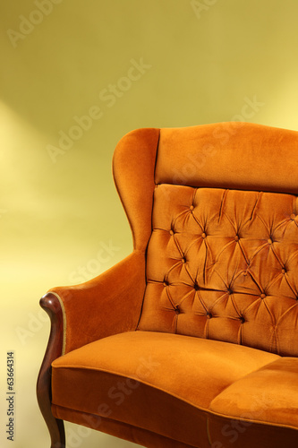 Old stlye sofa on green background