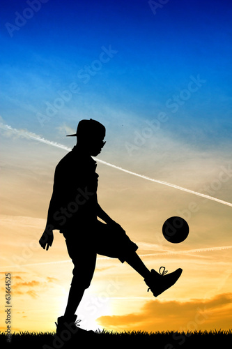 man dribbles at sunset