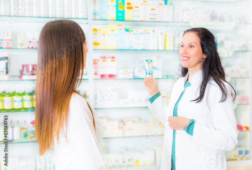 pharmacist suggesting medical drug to buyer in pharmacy drugstor