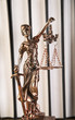 Lady of justice, wooden & gold gavel and books on wooden table - 63665569