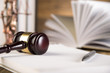 Lady of justice, wooden & gold gavel and books on wooden table - 63665986